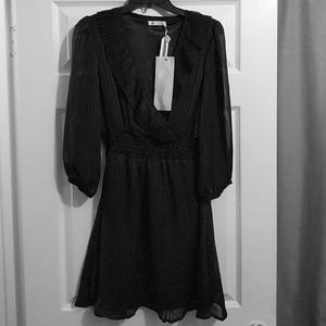 Never worn, tags attached, gorgeous black dress